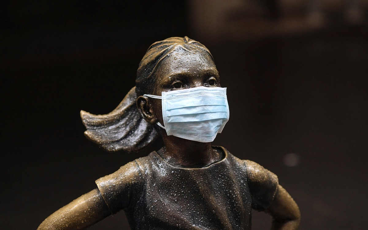 Statue of a girl wearing a mask.